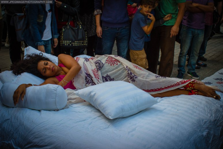 "Female artist posing/sleeping on a bed as ""live art"" at the DUMBO Arts Festival in Brooklyn New York, Saturday September 28, 2013."