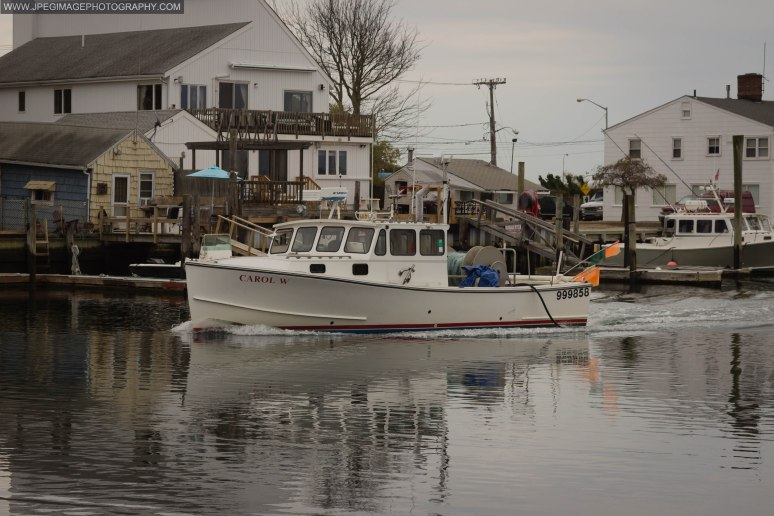 Fishing boat traveling through Nautical Mile.