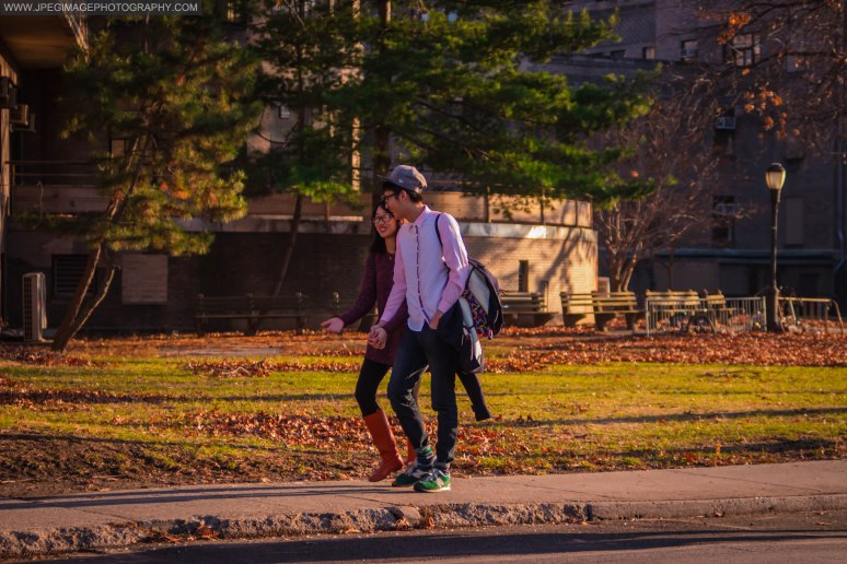 Asian couple walking downs a local street in Roosevelt Island New York Saturday December 21, 2013.