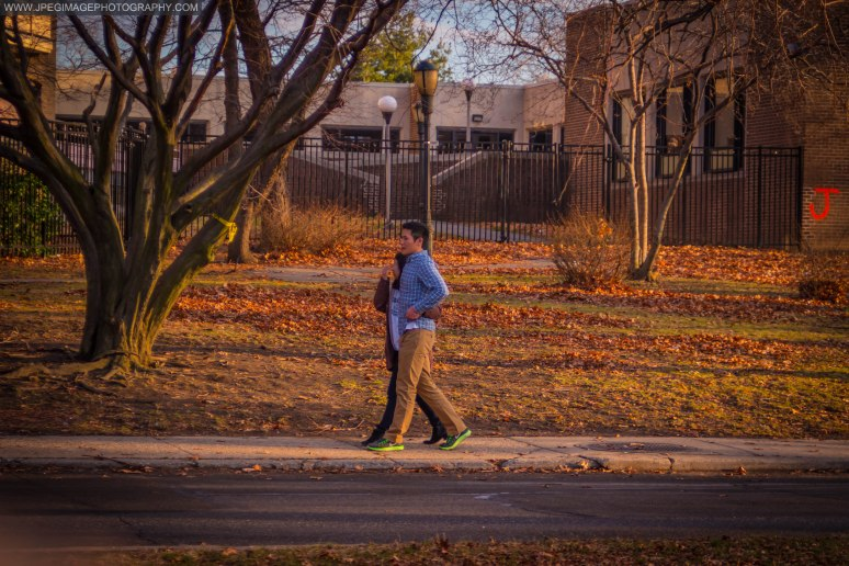Couple walking downs a local street in Roosevelt Island New York Saturday December 21, 2013.