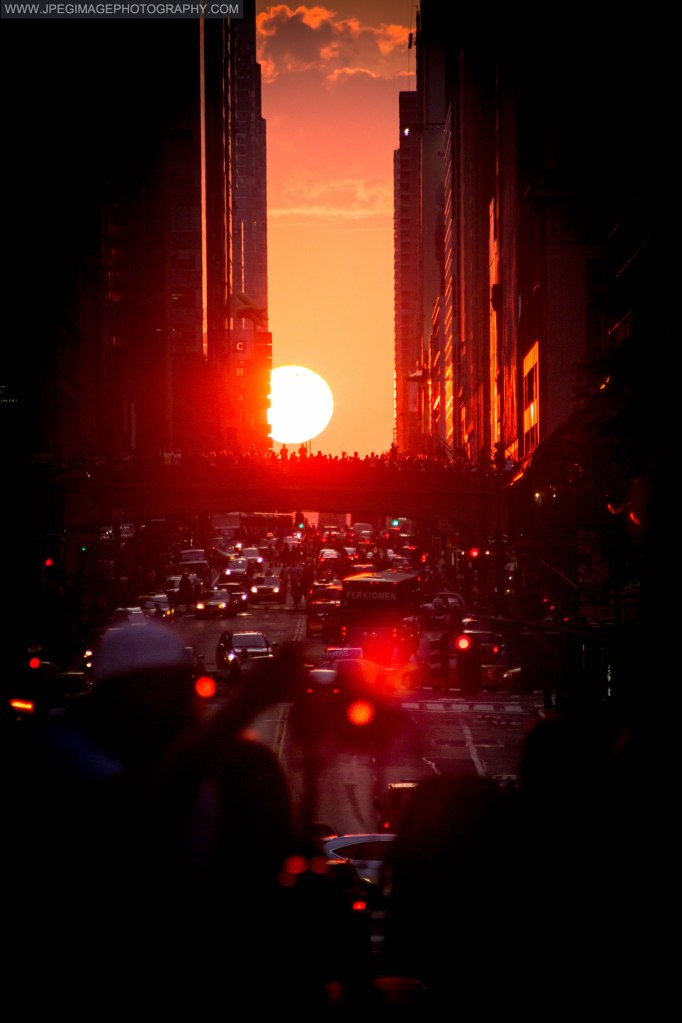Manhattanhenge sunset on 42nd street Manhattan New York, Friday July 11, 2014.