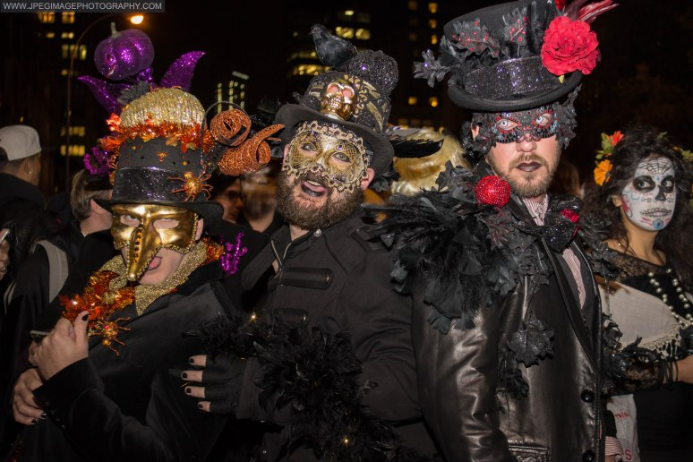 Portrait of three people dressed as random characters during the New York City Halloween parade.