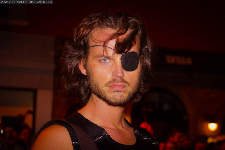 Portrait of a random male dressed as fictional character Snake Plissken during the New York City Halloween parade.