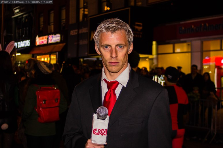Portrait of a random male dressed as CNN anchor Anderson Cooper during the New York City Halloween parade.